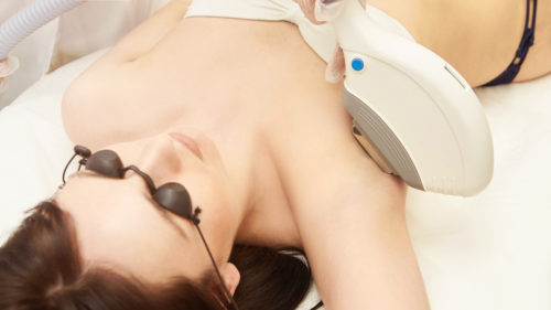 Medical beauty laser cosmeology procedure. Young female at salon. Professional doctor. Woman skincare technology. Hair removal
